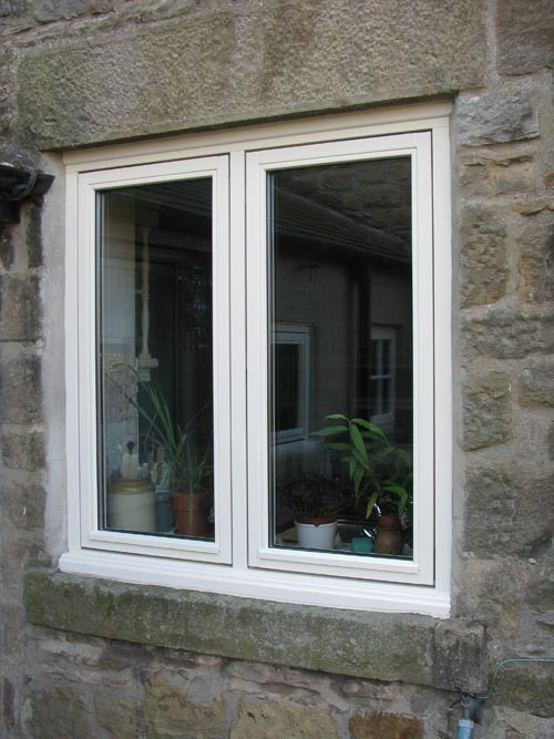 Timber casement window set in old stone