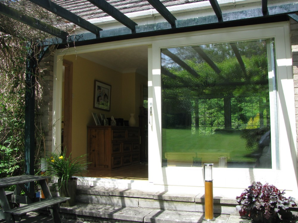 Large patio timber doors leading to garden